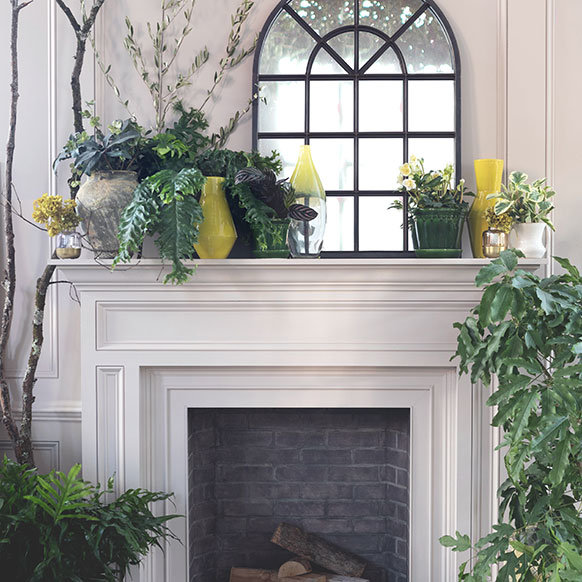 An eye-catching mantel design for 2020 | natural finishes, organic shapes + pops of green